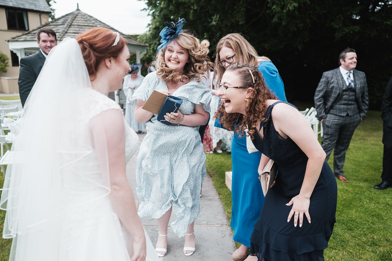 bride celebrates her wedding with friends