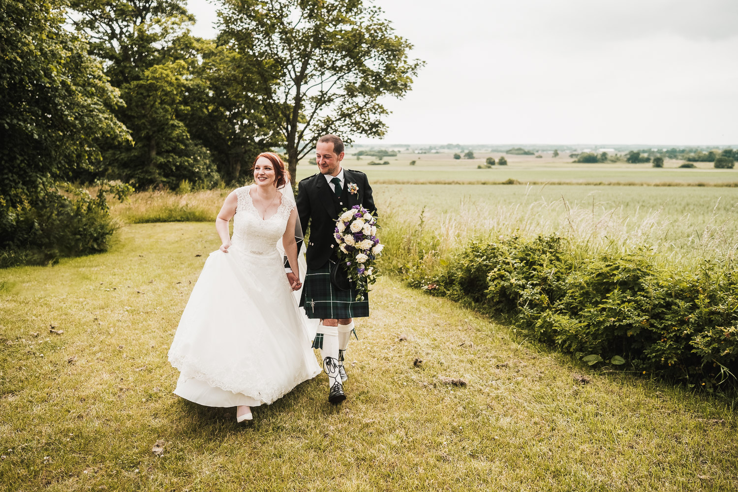 Bride and Groom take a walk at west tower