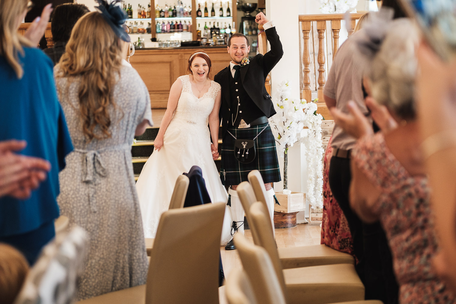 bride and groom are welcomed into west tower wedding breakfast