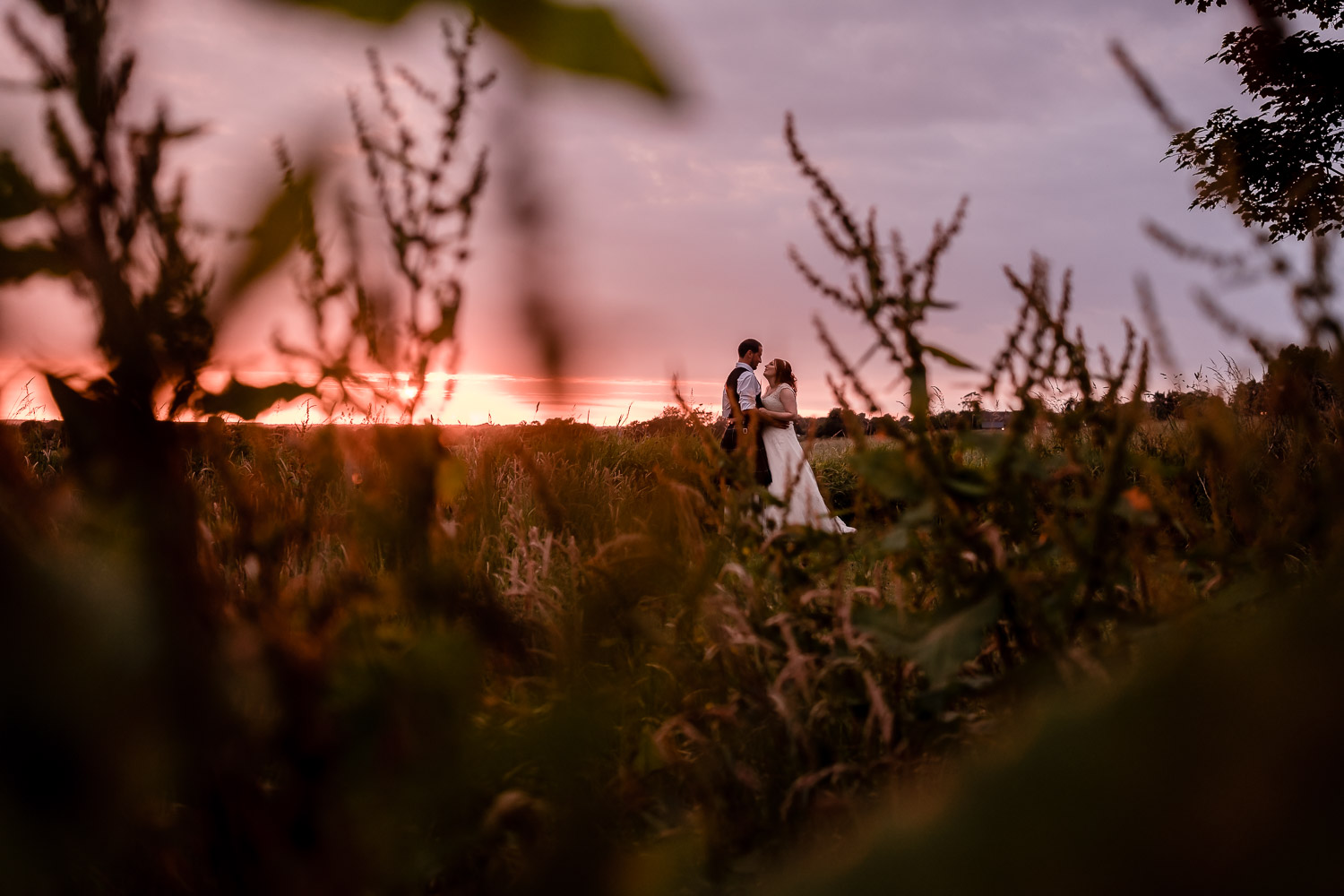bride and groom enjoy a sunset at west tower