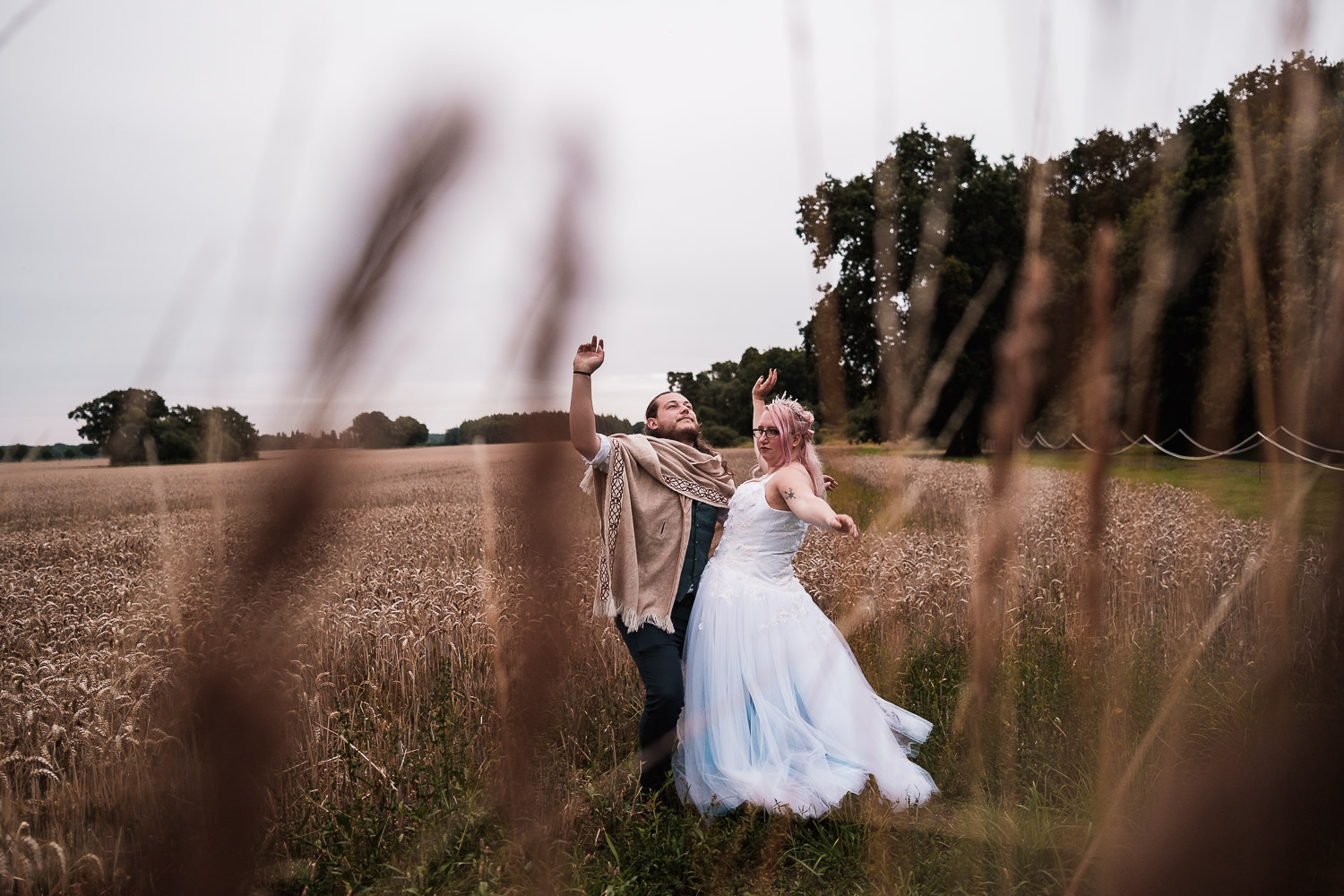 The bride and groom are playful at their Escrick park estate wedding