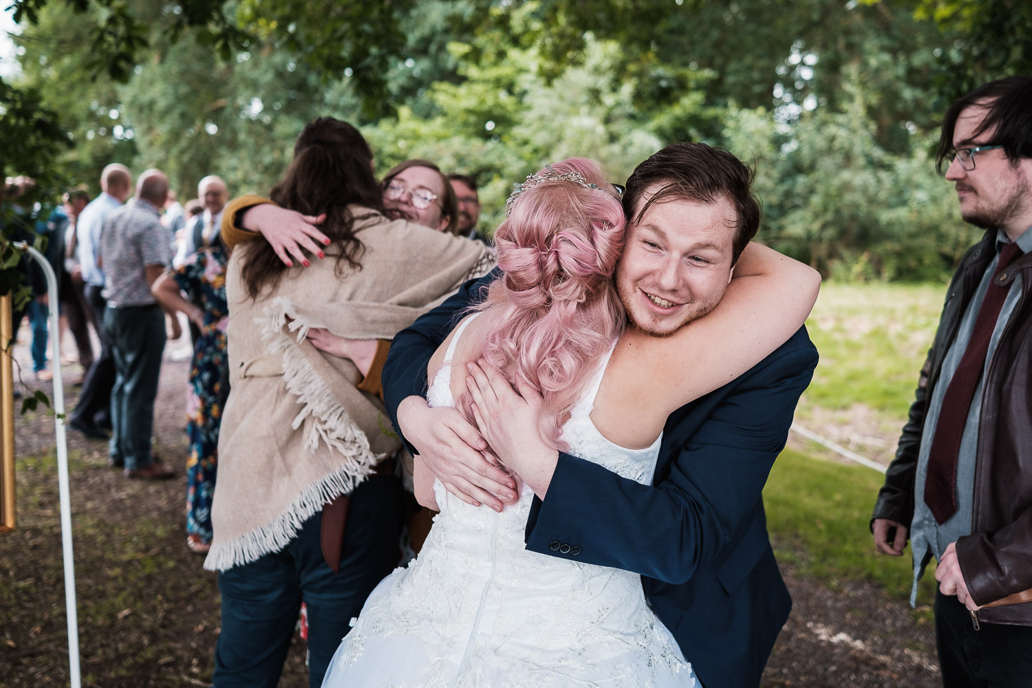 the bride and groom are embraced by their guests at their Escrick park estate ceremony