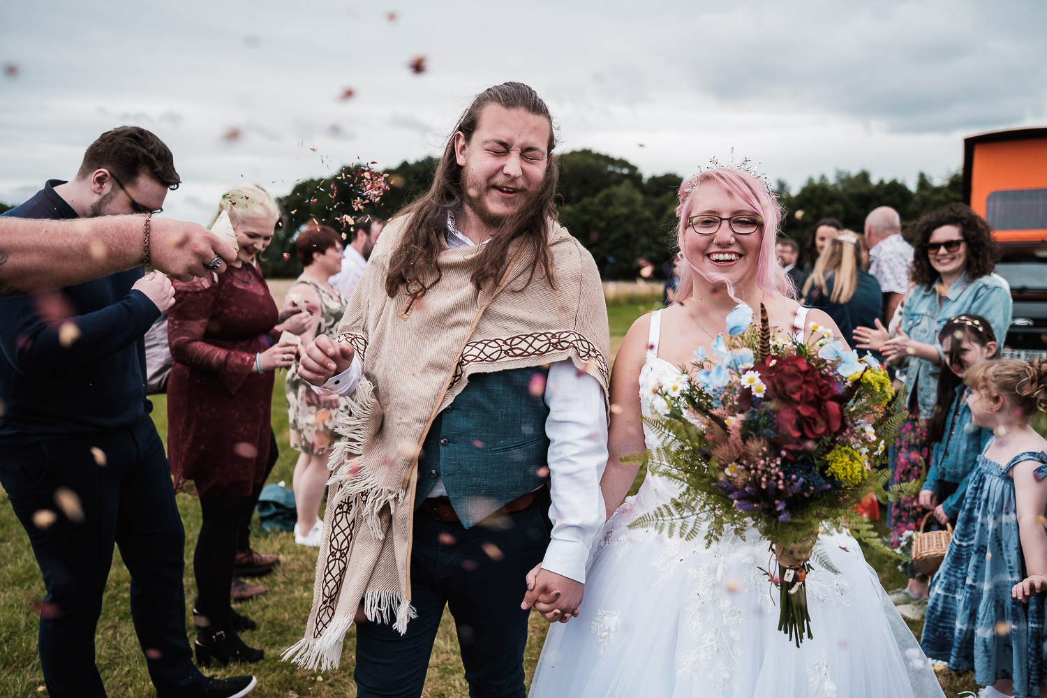 the bride and groom get showered with confetti at Escrick park