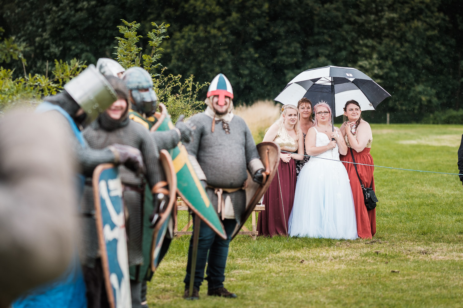 the bride and her bridesmaids watch the knights tournament