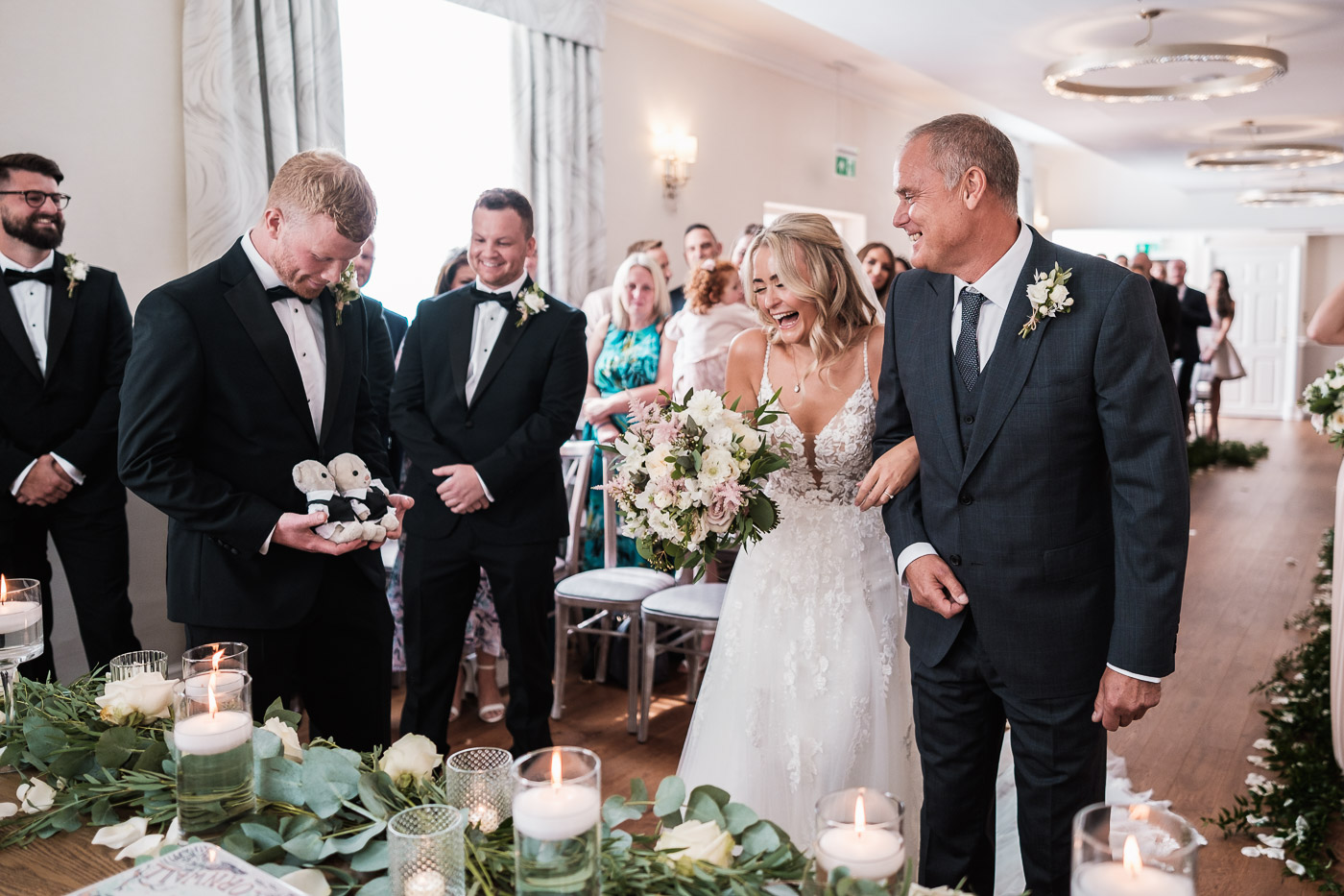 groom presents teddies to the bride at their old palace Chester ceremony