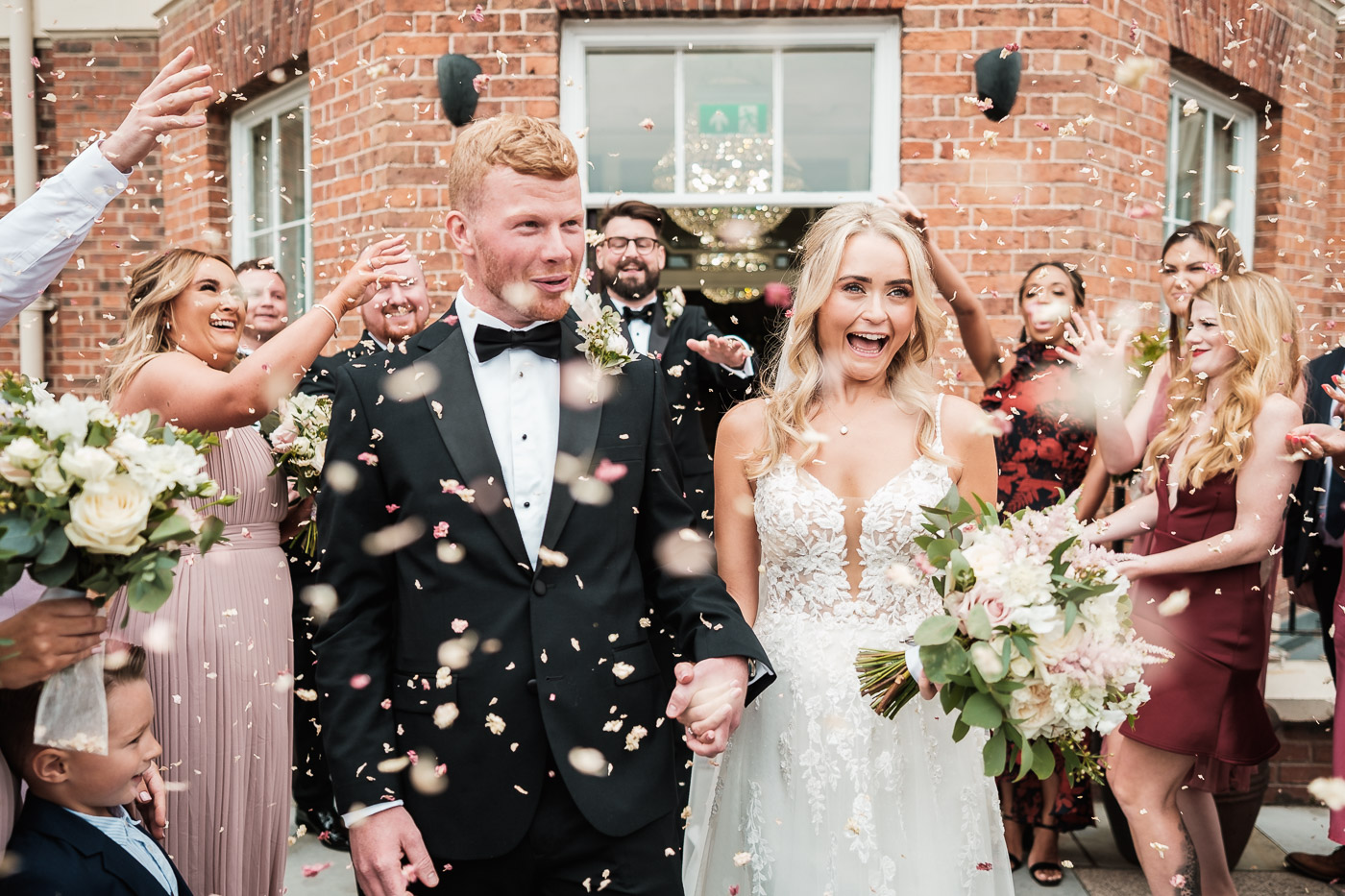 Bride and Groom are showered with confetti after their ceremony at the old palace in chester