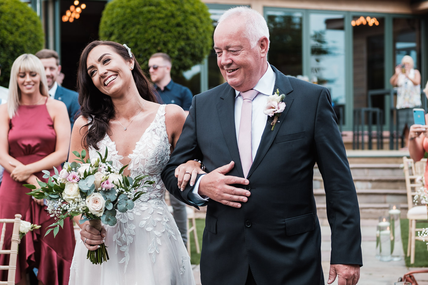 the bride enters her ceremony with her dad at Pryors Hayes Gold Club Wedding