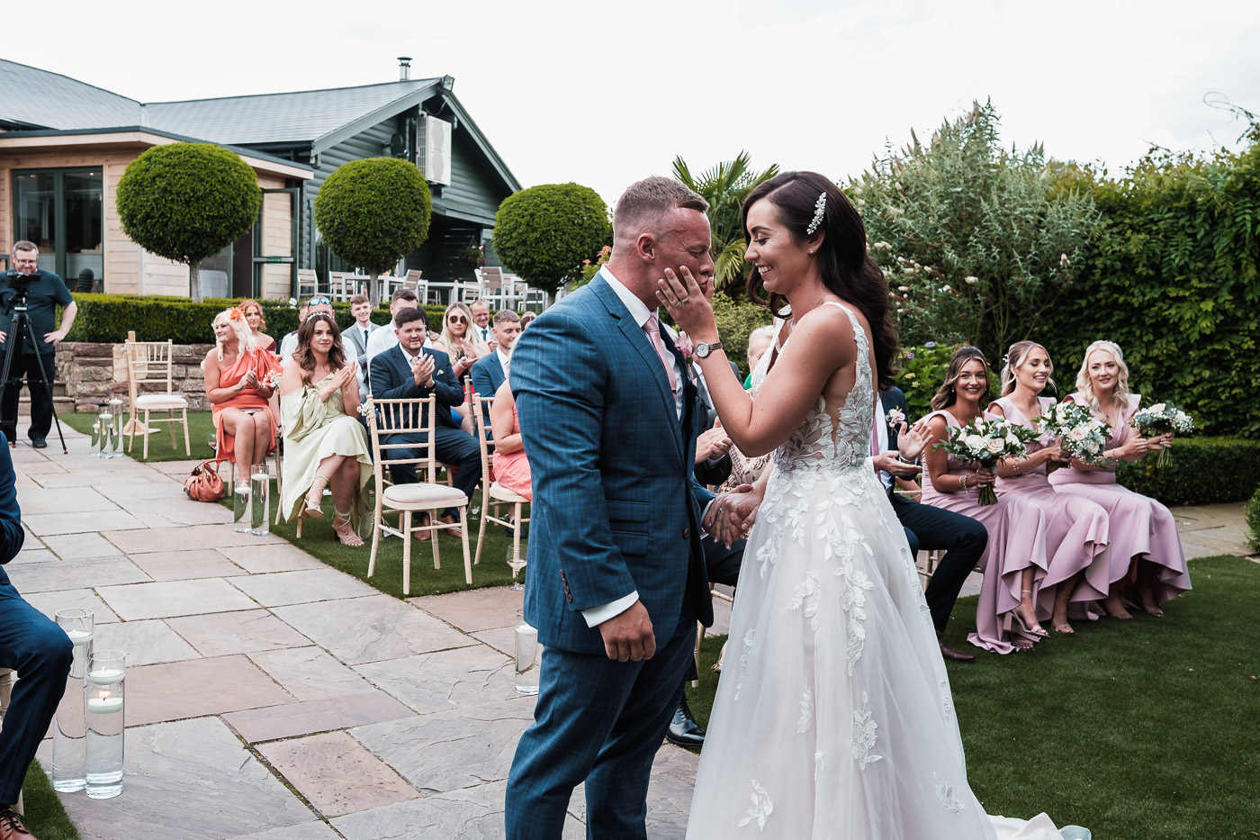The Bride embraces the groom at the outdoor wedding ceremony of their Pryors Hayes Golf Club Wedding