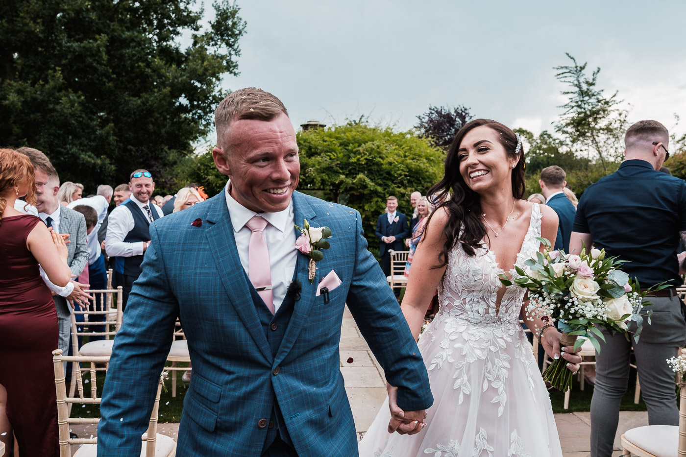 The happy couple leave their Pryors Hayes outdoor ceremony