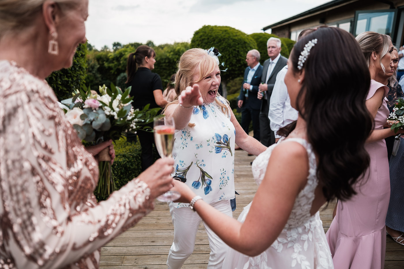 bride is embraced by an excited mother of the groom on their wedding day at Pryors Hayes in chester