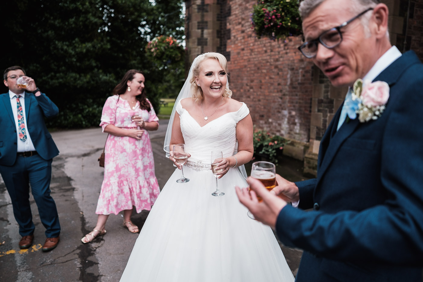 bride and groom laugh at a drinks reception in warrington