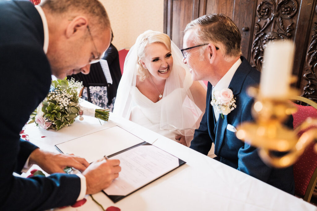 The wedding schedule is signed at Walton hall